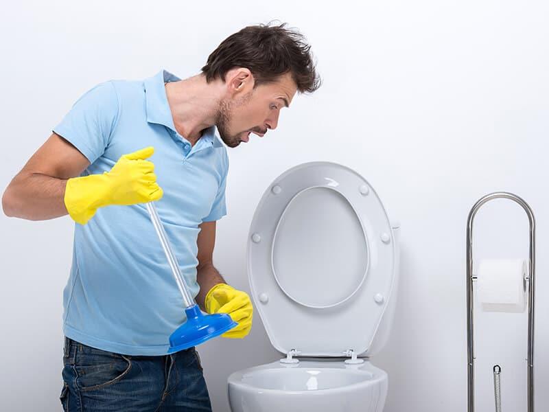 Unclogging Toilet